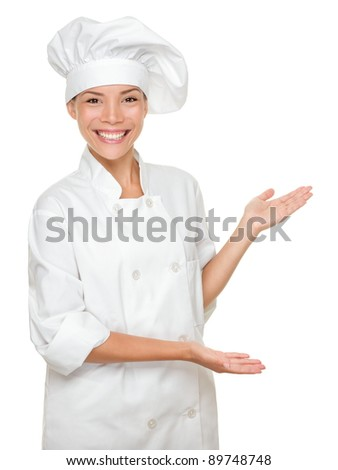 Cook or chef showing and presenting. Woman chef isolated on white background. Multicultural Caucasian Asian model. - stock photo
