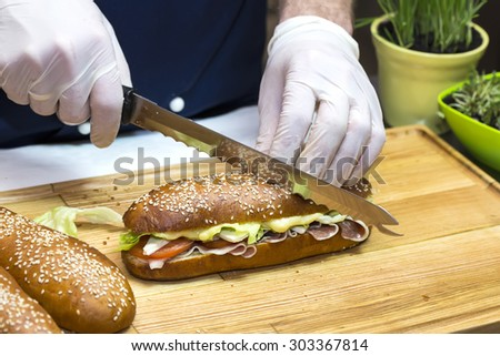 cook prepares canapes in the kitchen at the restaurant - stock photo