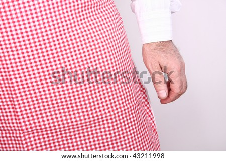 cook standing in front of white background - stock photo