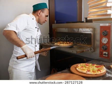 Cook took the pizza from the oven ready