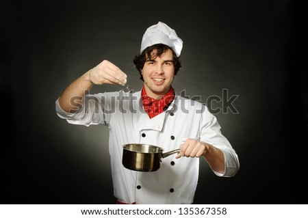 Cook with pot on a black background