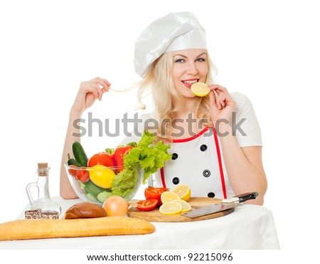 Cook with vegetables at the table, preparing
