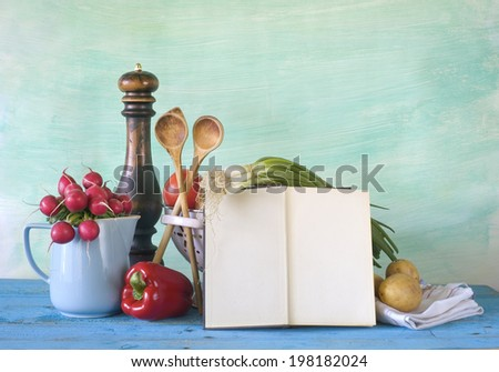 cookbook, vegetables, kitchen utensils, free copy space - stock photo