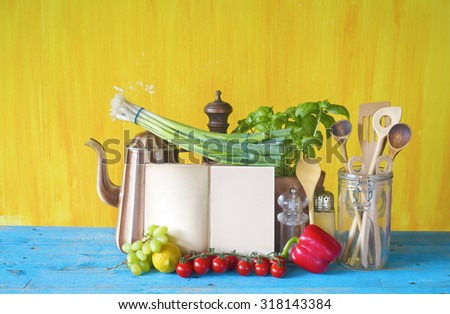 cookbook, vegetables, old kitchen utensils, free copy space - stock photo