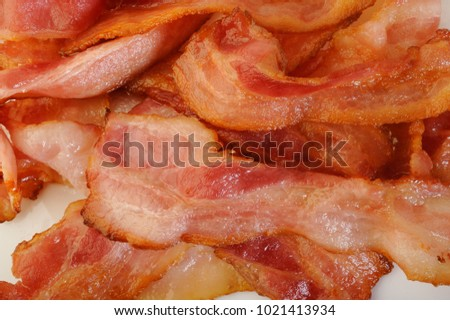Cooked bacon rashers on white background