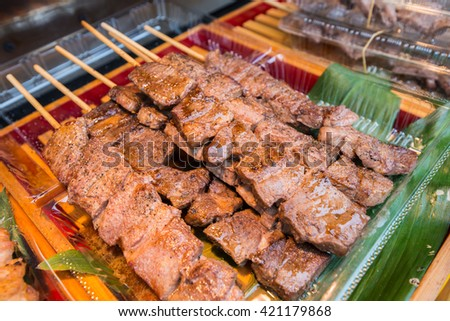 Cooked beef steak on stick ready to eat