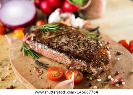Cooked Beef Steak with Vegetables and Spices - stock photo
