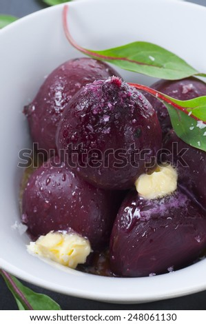 Cooked beets with melted butter and sea salt. New version. - stock photo