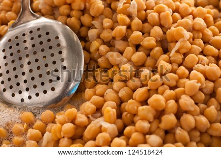 cooked chickpeas with straining ladle - stock photo