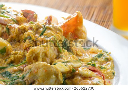 cooked curry crabs with spicy sauce on white plate - stock photo