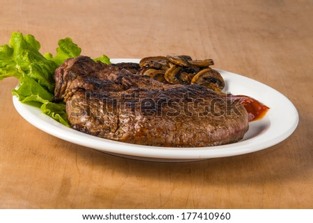 Cooked delicious grilled steak barbecue - stock photo