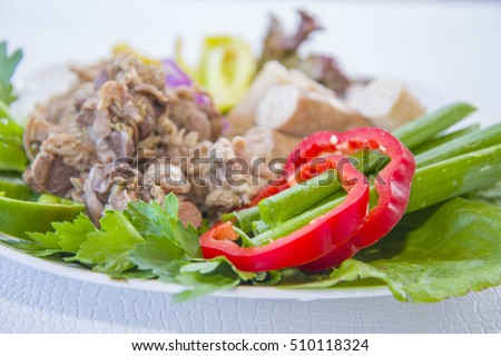 Cooked entrails of sheep (intestines, stomach) with vegetables.