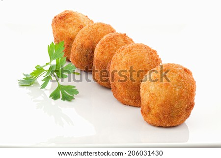 Cooked fritters on white background