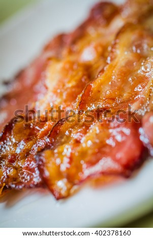 Cooked Greasy Bacon against a back ground - stock photo