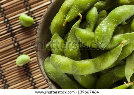 Cooked Green Organic Edamame with sea salt against a background - stock photo