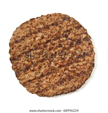 Cooked minced beef patty isolated on white background from overhead