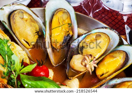 Cooked mussels and seafood sauce, selective focus - stock photo