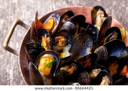 cooked mussels in a copper pot - stock photo