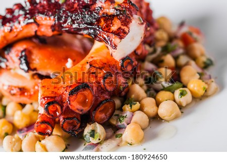 Cooked Octopus Plate with Chickpeas in a Portuguese Restaurant - stock photo