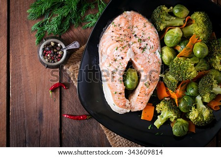 Cooked on steam salmon steak with vegetables. Top view - stock photo