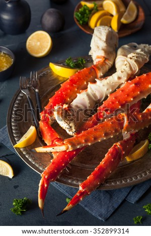 Cooked Organic Alaskan King Crab Legs with Butter - stock photo