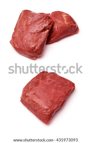 Cooked Ostrich (Struthio camelus) meat steaks isolated on a white studio background.