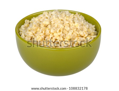 cooked pearl barley in a green bowl isolated on white background - stock photo