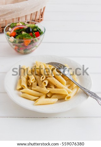 cooked penne with useful vegetables salad