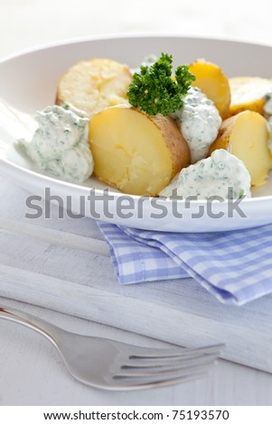 cooked potatoes and cream cheese on a plate