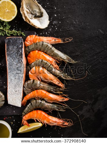 Cooked prawns served on black stone - stock photo