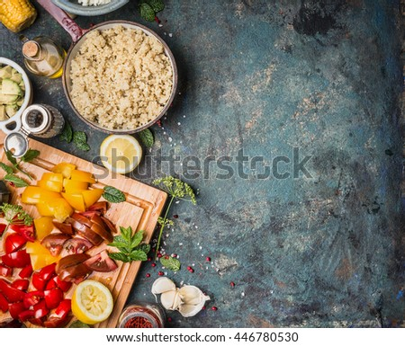 Cooked quinoa in cooking pot with fresh ingredients for salad making on dark rustic background, top view, border. Superfood and healthy Eating concept - stock photo