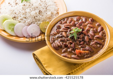 cooked red kidney beans curry and cooked basmati rice, rajma chawal or rajma rice, traditional north indian lunch, dinner or breakfast menu