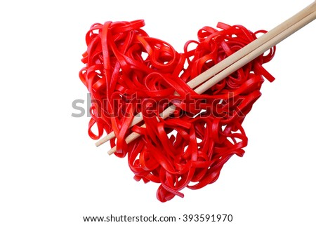 cooked red pasta arranged in a heart shape. red heart-shaped spaghetti and chopsticks, symbolizing the arrow pierces the heart. isolated on white background - stock photo