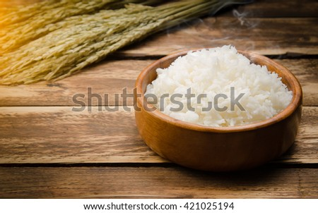 Cooked rice and paddy rice on wood