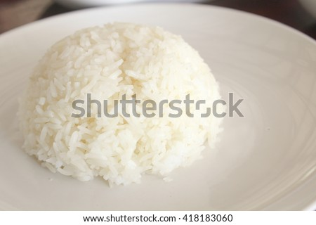 cooked rice and rice grain on jute cloth. jasmine rice. cooked jasmine rice and jasmine rice grain. cooked rice and rice grains.