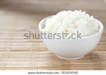 cooked rice in white cup. - stock photo
