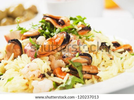 Cooked rice, risotto with mussels and shrimps