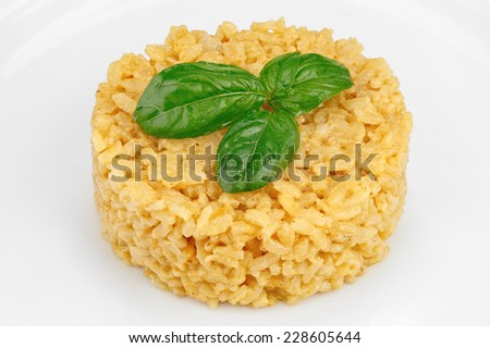 Cooked rice with spices and basil leaf - stock photo