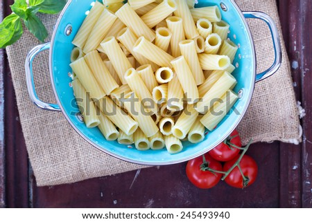 Cooked rigatoni pasta in a colander top view - stock photo