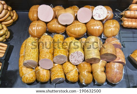cooked sausage in the store and supermarket - stock photo