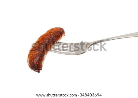 Cooked sausage on a fork isolated against white - stock photo