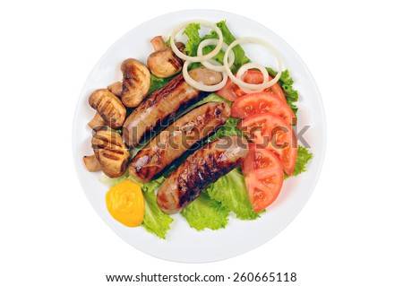 Cooked sausages with mustard, green lettuce, tomato, mushrooms and onion on a plate, white background