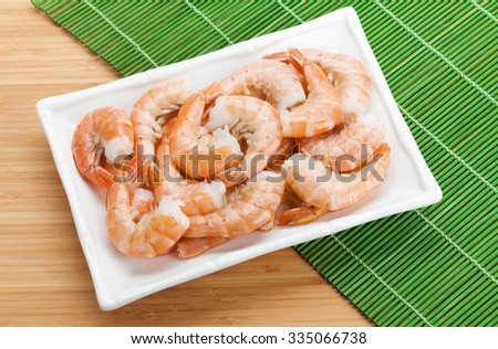 Cooked shrimps. View from above on wooden table - stock photo