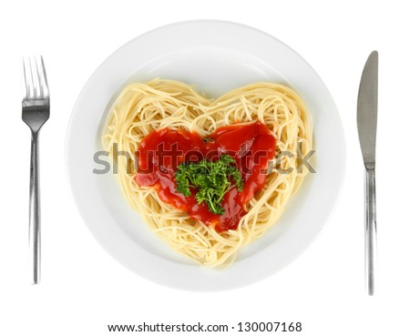 Cooked spaghetti carefully arranged in  heart shape and topped with tomato sauce, isolated on white - stock photo