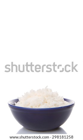 Cooked steamed rice in a blue bowl over white background