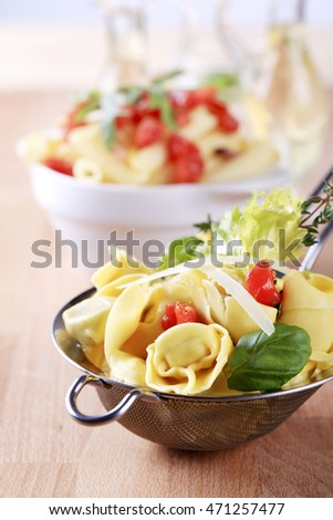 Cooked stuffed pasta in a metal sieve