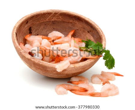 cooked unshelled tiger shrimps fall down with bowl - stock photo