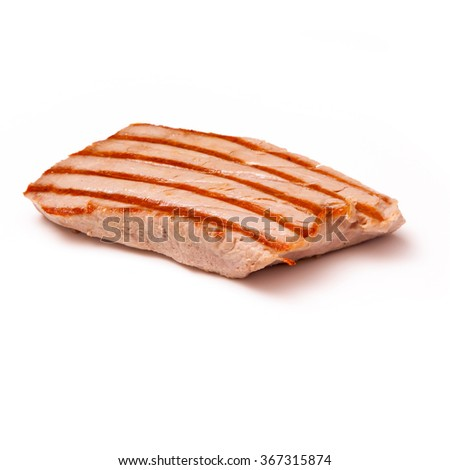 Cooked yellowfin tuna fish steaks (thunnus albacares) isolated on a white studio background. - stock photo