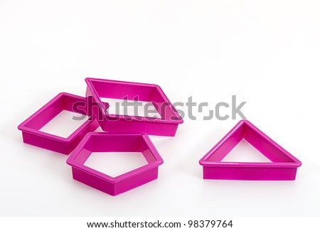 Cookie biscuit cutters over white - stock photo