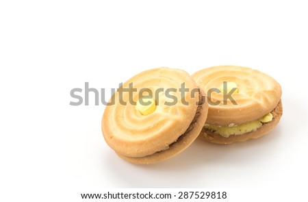 cookie biscuit with cream on white - stock photo